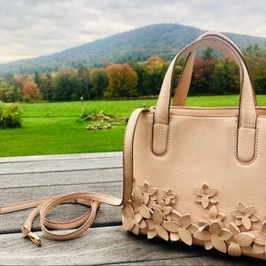 this is a pastel pink purse  by Lauren Conrad